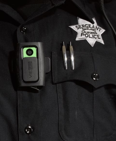 "In 2010 the Oakland, CA, Police Department became the first large police force in the country to wear body cameras that record everything the officers see, say, and do. Chief Sean Whent describes the transition:<br /> ""There was some skepticism at first, but the officers have been won over. They really see the value in it. The cameras show that they are hardworking and do the right thing consistently. There are other factors to attribute this to as well, but over the last two years we're looking at a more than 50 percent reduction in complaints. Those complaints that do come in, we're able to resolve them a lot faster. And while occasionally we'll catch somebody doing something they shouldn't be, the video evidence used in complaints overwhelmingly supports the police—more than 90 percent support the officer.<br /> ""It used to be that you turn on the camera when you get out of the car to walk up to the car you've pulled over. We realized that works great for your routine car stop, but it does not work if it becomes a pursuit. So now, before you even attempt to make a car stop, you turn on the camera.<br /> ""The cameras are not perfect. They show a frontal view from the direction the officer's chest is facing, but that doesn't necessarily mean the officer is looking in that direction or that he isn't talking to somebody at his side. Also, nighttime video is not great. The technology may improve, but you don't want better vision than the officer is capable of seeing either, because then there's no way to know what the officer actually saw.<br /> ""One of our major goals as a police department over the last few years has been to work on trust within the community. This is the way of the future. Law enforcement going forward has to be dedicated to some level of transparency. The public demands that, and rightfully so.""<br />"