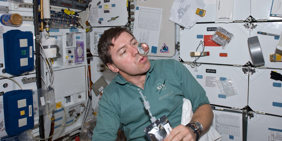 astronaut drinking beer in space - photo #23