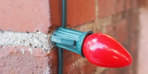 Attaching String Lights To House : How to Use Hot Glue to Fasten Christmas Lights to Brick or Stucco