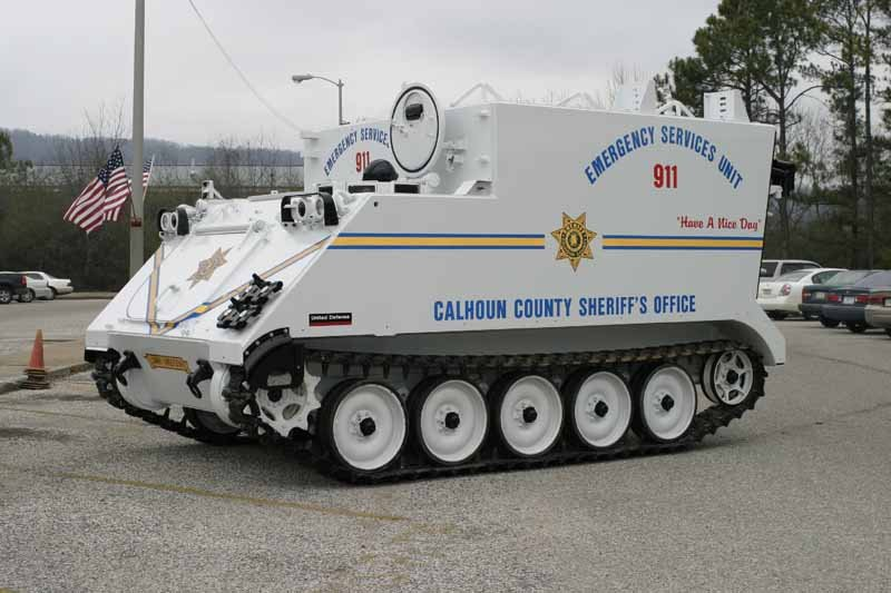 police tanks and armored personnel carriers are strangely