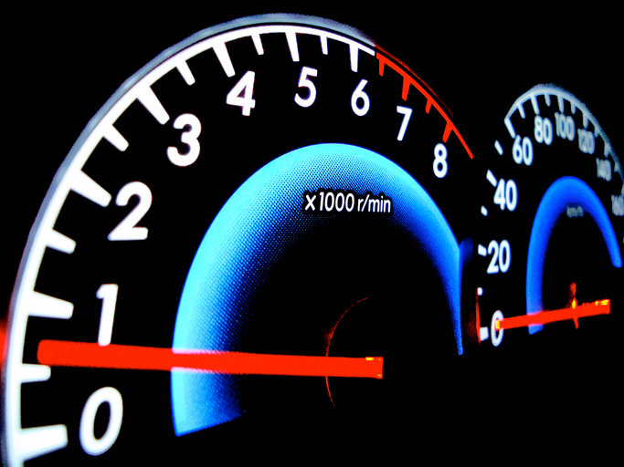 analog speedometer of a car showing round per minute indicator and velocity indicator