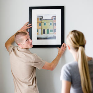 the proper way to hang a picture. Black Bedroom Furniture Sets. Home Design Ideas