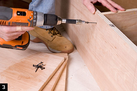 Apply carpenteru0027s glue to the dadoes, set the plywood shelves in place and  secure them with 1 5/8-in. drywall