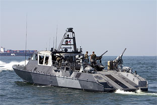 Behind The Scenes With A Special Ops Gunboat Crew
