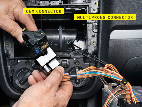 how to install an ipod adapter in your car step by step instructions then we unscrewed a couple of torx fasteners and pulled the radio straight out of the dash pull the multiprong connector from the radio back
