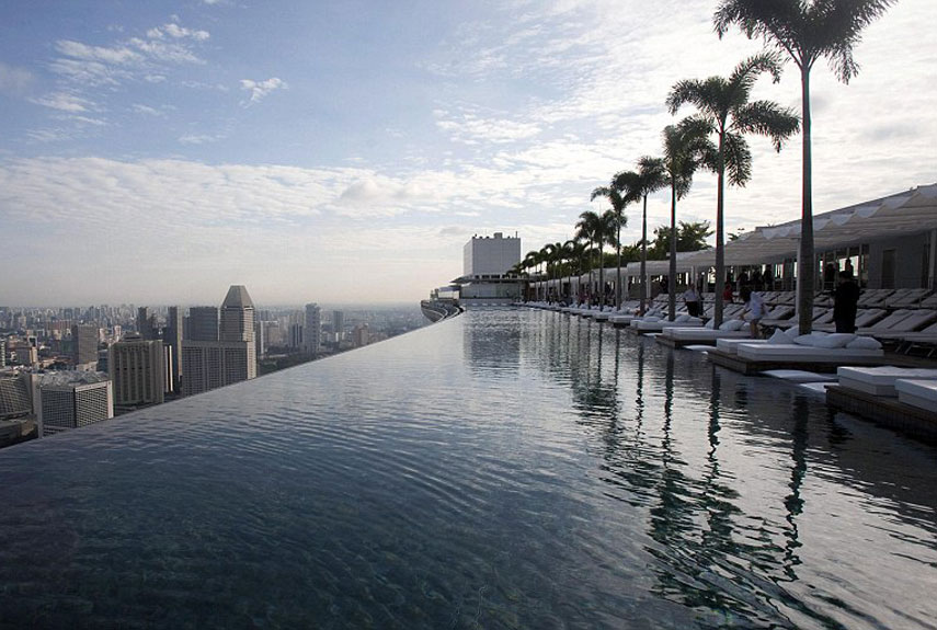 Where: Singapore<br /><br /> Singapore's SkyPark at the Marina Bay Sands offers an infinity pool with a first-class view—55 stories up. Perched atop the three towers of the world's most expensive hotel, the water seamlessly flows over the edge, into a catchment and back into the pool. The pool itself touches all three buildings and is longer than the Eiffel Tower laid on its side.<br /><br />