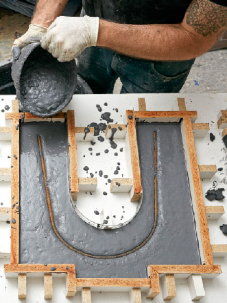 Immediately pour enough to fill each leg mold to within 1 inch of the top,  working it into the corners. Once the concrete starts stiffening, set the  rebar ... - Build This Beautiful Concrete Bench