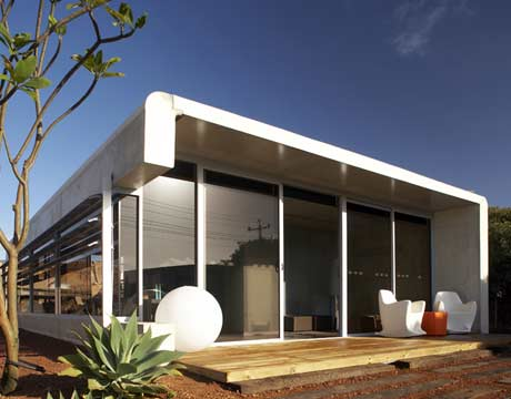 front view of the modern glass walled perrinepod prefabricated modular home - Modular Home Designs