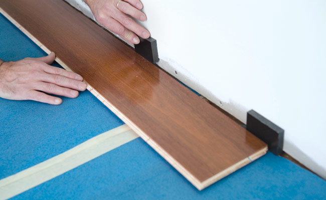 Lay out all the planks for the first row, checking to make sure the last  one will be at least 8 in. long. If necessary, cut the first plank so the  last ... - How To Install A Hardwood Floor How To Build A Hardwood Floor