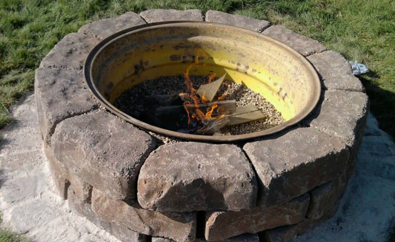 Place the rim on its side and you've got an instant fire pit. Surround it with bricks to protect hands and feet from hot steel.