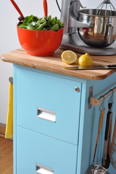 Add some fresh paint, casters, a butcher block top, and some hardware, and you've got the perfect kitchen cart or island. Source: Curbly.