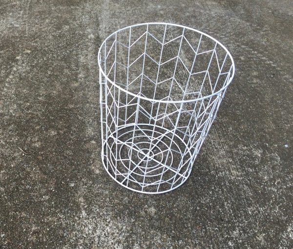 A typical wire wastebasket doesn't seem very inspiring.