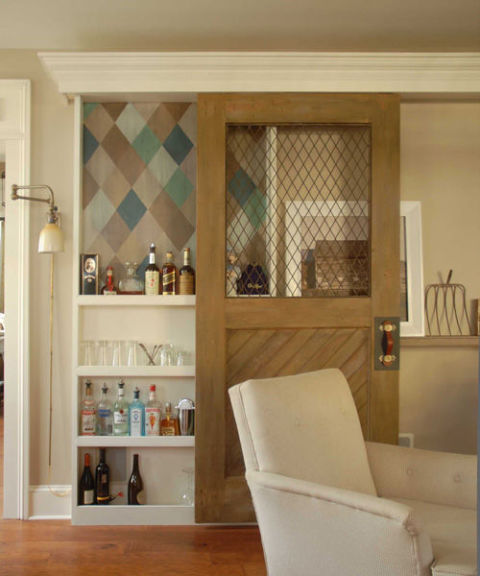 Convert your door into a sliding screen that reveals a hidden pantry. Source: Design*Sponge