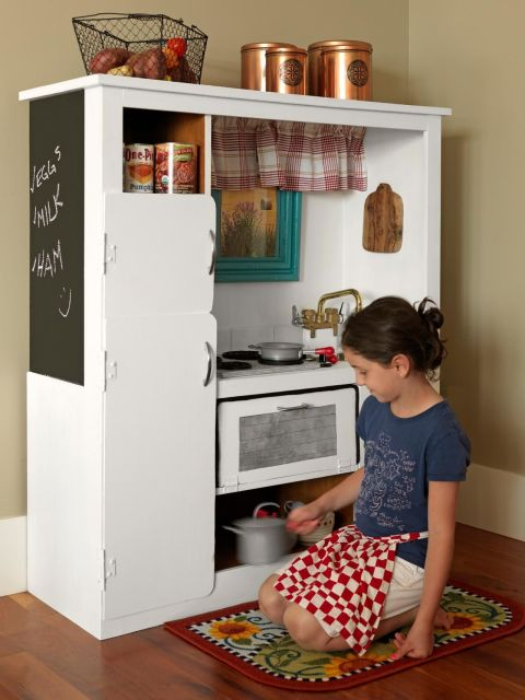 With a little paint and a few pieces of hardware, you can transform that sad entertainment center into a fun play kitchen for kids.